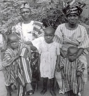 """The Soyinka Family, 1938. S.A. (Essay) and Eniola (the Wild Christian) with Wole, Tinu and Femi."" Photograph. Wole Soyinka. Academy of Achievement, 1996. Web. 24 Sep. 2010."